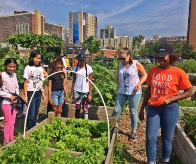Promise Garden Volunteers and Kids at Garden Plot
